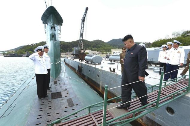 North Korean leader Kim Jong Un boards a submarine during his inspection of the KPA Naval Unit 167