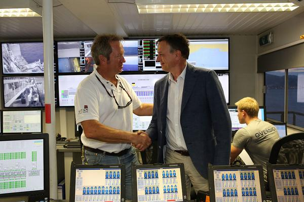 Michael Thamm, CEO of Costa Crociere, congratulates Titan-Micoperi Salvage Master Nick Sloane on a job well done in the control room onboard the Costa Concordia, July 27, 2014. Photo courtesy The Parbuckling Project