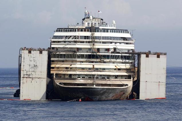 The prow of cruise liner Costa Concordia is seen during the refloat operation at Giglio harbour