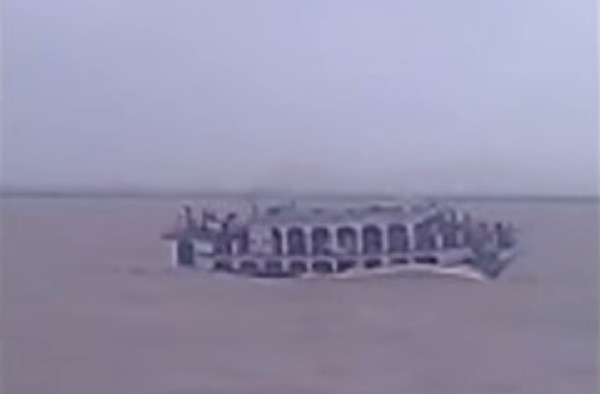 A overcrowded ferry seen just before capsizing in this screen grab from a video of the incident.