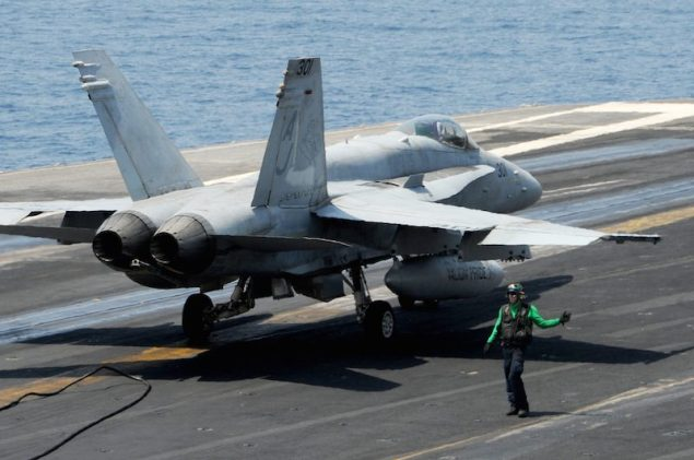 U.S. Navy file photo of an F/A-18C Hornet on the flight deck of the aircraft carrier USS George H.W. Bush (CVN 77). U.S. Navy Photo