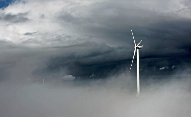wind turbine storm clouds power renewable energy