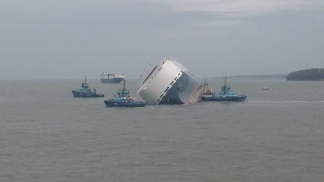 The Hoegh Osaka car carrier being assisted by tugs away the Bramble Bank after the ship self-floated, January 6, 2015. Photo courtesy Casey Sheargold