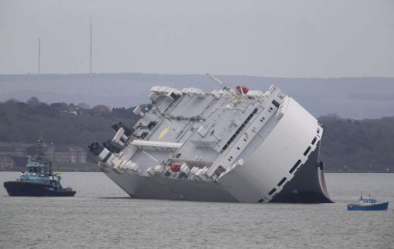 The Hoegh Osaka car carrier aground on the Bramble Bank in the Solent estuary, near Southampton in southern England January 5, 2015. REUTERS/Peter Nicholls