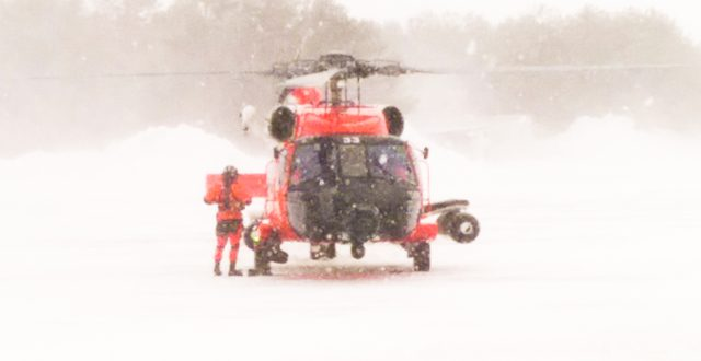 A Coast Guard Air Station Cape Cod helicopter crew returns from rescuing a father and son from a sailboat about 150 miles south of Nantucket, Mass., Feb. 15, 2015. After navigating through low visibility and near hurricane force winds, the crew safely hoisted the men and returned to Air Station Cape Cod. (U.S. Coast Guard photo contributed by Coast Guard Air Station Cape Cod)