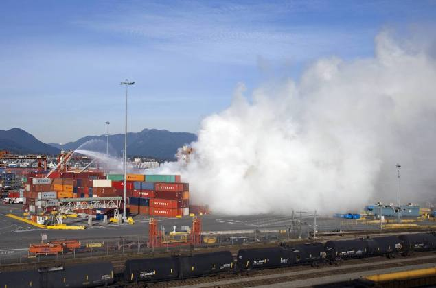 Smoke from a fire rises at the Port Metro Vancouver March 4, 2015. REUTERS/Ben Nelms