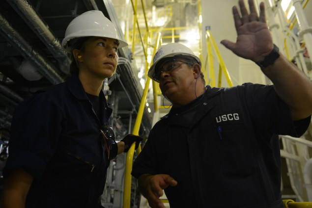 Tim Wilcox and Petty Officer 2nd Class Cindy Washburn, port state control officers at Coast Guard Sector Honolulu Prevention, conduct an inspection of the engine room aboard the 600-foot Panamanian-flagged bulk freight ship Teizan, at Kalaeloa Barbers Point Harbor, May 19, 2015. Coast Guard crewmembers conduct inspections to ensure a vessel has a suitable structure, correct documentation, proper working equipment and lifesaving equipment, and adequate accommodations. (U.S. Coast Guard photo by Petty Officer 2nd Class Tara Molle)
