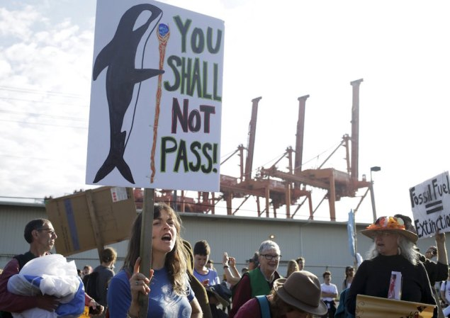 Activists march and rally at the entrance of Terminal 5 to protest Shell Oil Company's drilling rig Polar Pioneer which is parked at the Port of Seattle, Washington May 18, 2015. U.S. Coast Guard Photo