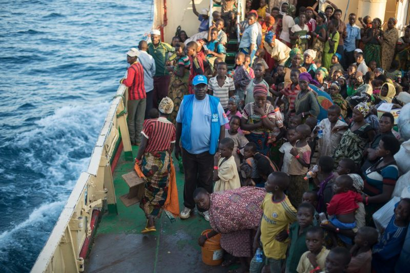 UNHCR coordinator on foredeck among refugees