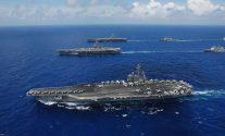 USS Ronald Reagan (CVN 76) (foreground). File Photo: Creative Commons