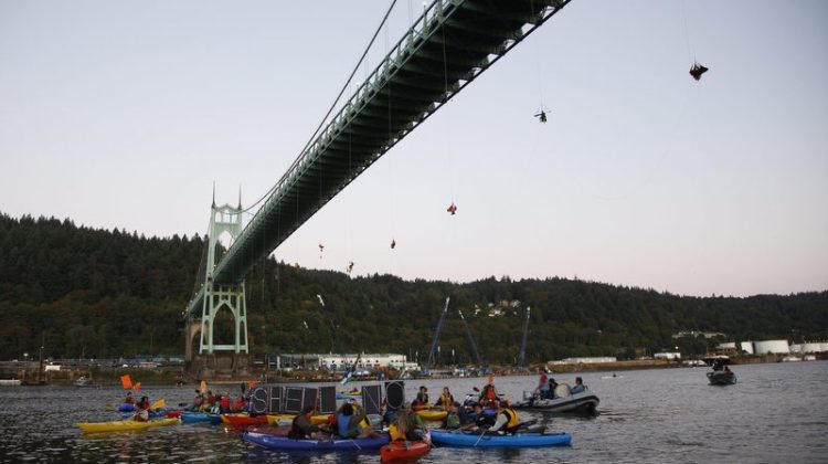 Activists suspend themselves from Portland's St. Johns Bridge in an attempt to block Shell's icebreaker from returning to Alaska. Photo: Greenpeace