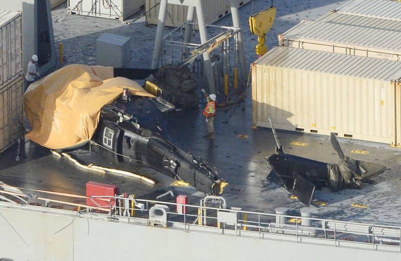 A damaged U.S. Army helicopter rests on the desk of the USNS Red Cloud off Okinawa island, southern Japan, in this photo taken by Kyodo August 12, 2015. The helicopter crashed in waters off the Japanese southern island of Okinawa during a training mission on Wednesday, injuring six people and prompting Japan's government to demand a probe and steps to prevent a recurrence. Mandatory credit REUTERS/KyodoATTENTION EDITORS - FOR EDITORIAL USE ONLY. NOT FOR SALE FOR MARKETING OR ADVERTISING CAMPAIGNS. THIS IMAGE HAS BEEN SUPPLIED BY A THIRD PARTY. IT IS DISTRIBUTED, EXACTLY AS RECEIVED BY REUTERS, AS A SERVICE TO CLIENTS. MANDATORY CREDIT. JAPAN OUT. NO COMMERCIAL OR EDITORIAL SALES IN JAPAN.      TPX IMAGES OF THE DAY