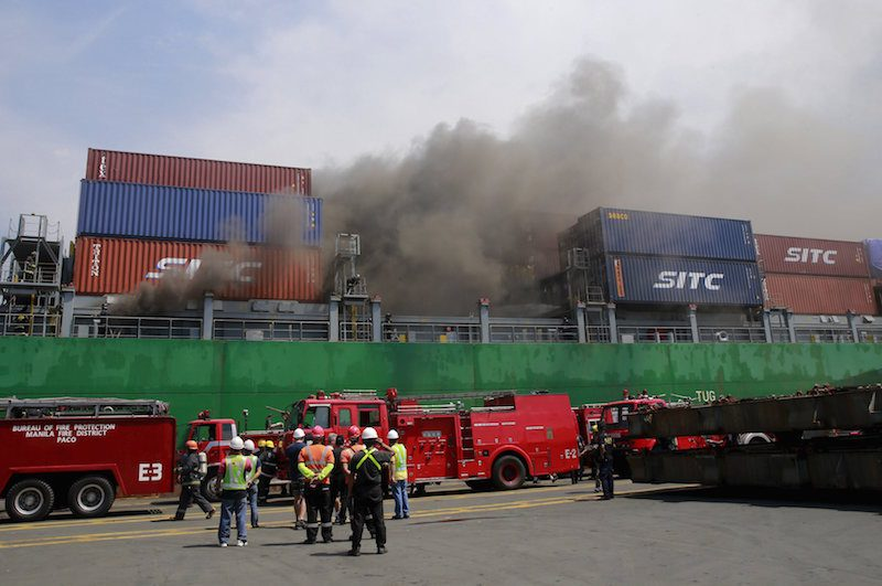 Smoke billows from the M/V Cape Moreton cargo ship after it caught fire while anchored at the Manila International Container Terminal (MICT) on September 12, 2015. Authorities have yet to determine the cause of the fire, local media reported. REUTERS/Romeo Ranoco