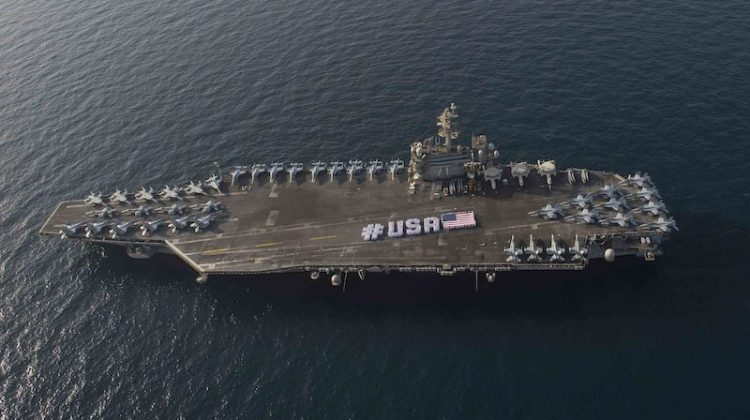 150628-N-VC236-071 ARABIAN GULF (June 28, 2015) - Sailors spell out #USA with the American flag on the flight deck of the aircraft carrier USS Theodore Roosevelt in honor of the nation's upcoming Independence Day weekend. Theodore Roosevelt is deployed to the U.S. 5th Fleet area of operations as part of Theodore Roosevelt Carrier Strike Group supporting Operation Inherent Resolve, strike operations in Iraq and Syria as directed, maritime security operations and theater security cooperation efforts in the region. (U.S. Navy photo by Mass Communication Specialist 3rd Class Jackie Hart/Released)