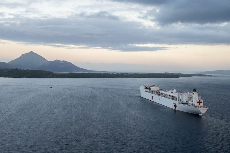 150706-N-BK290-719 RABAUL, Papua New Guinea (July 6, 2015) The Military Sealift Command hospital ship USNS Mercy (T-AH 19) sits at anchorage in Simpson Harbor off the coast of Rabaul, Papua New Guinea. Mercy is in Papua New Guinea for its second mission port of Pacific Partnership 2015. Pacific Partnership is in its tenth iteration and is the largest annual multilateral humanitarian assistance and disaster relief preparedness mission conducted in the Indo-Asia-Pacific region. (U.S. Navy photo by Chief Mass Communication Specialist Christopher E. Tucker/Released)