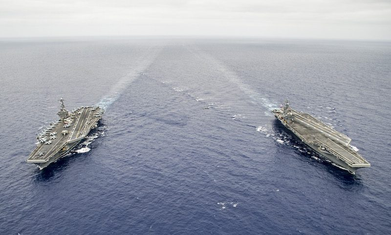 150807-N-IP531-388 PACIFIC OCEAN (Aug. 7, 2015) The Nimitz-class aircraft carriers USS George Washington (CVN 73), left, and USS Ronald Reagan (CVN 76) are underway before conducting a hull-swap. Ronald Regan will replace George Washington in Japan. The force structure change allows George Washington to undergo its mid-life refueling complex overhaul and Ronald Reagan to support the security and stability of the Indo-Asia-Pacific region. (U.S. Navy photo by Mass Communication Specialist 3rd Class Chris Cavagnaro/Released)