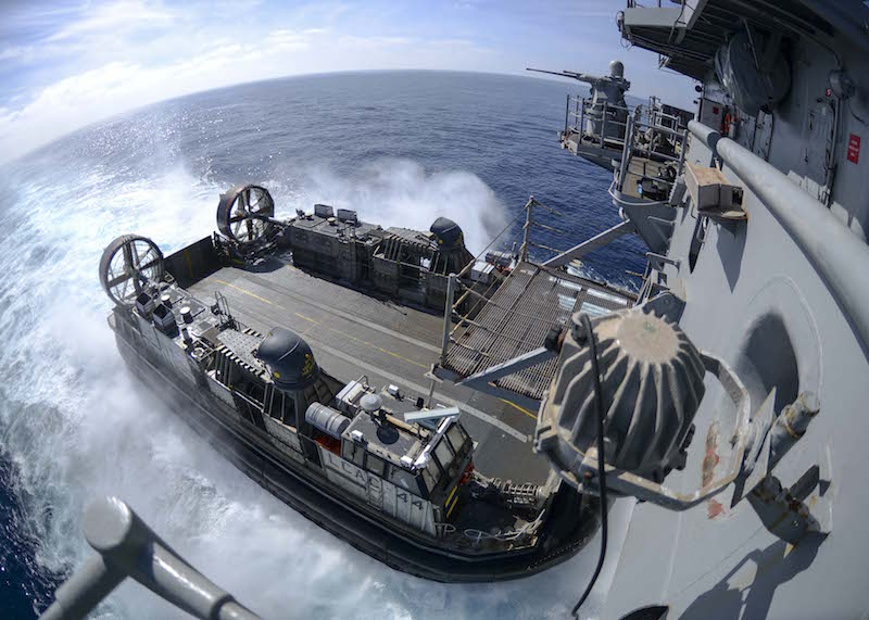 150928-N-GZ228-152 PACIFIC OCEAN (Sept. 28, 2015) Landing Craft Air Cushion (LCAC) 44, assigned to Assault Craft Unit (ACU) 5, approaches the well deck of the amphibious assault ship USS Boxer (LHD 4) during well deck operations. Boxer is underway off the coast of Southern California conducting routine training exercises and maintenance in preparation for its upcoming deployment. (U.S. Navy photo by Mass Communication Specialist 3rd Class Jesse Monford/Released)