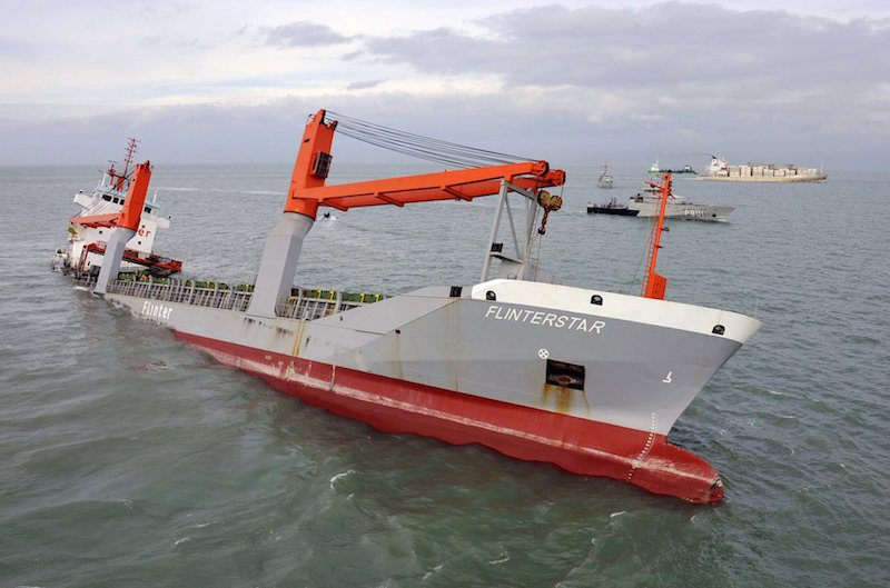Dutch freighter Flinterstar is seen sinking after colliding with Marshall Island-flagged tanker Al-Oraiq, which also suffered damage in the collision, in the North Sea off the Belgian coast October 6, 2015. The small Dutch freighter sank early Tuesday morning after colliding with the tanker in the North Sea off the Belgian coast, the Netherlands' coast guard said. All aboard were rescued. Coast Guard spokeswoman Vanessa Strijbosch said 11 of the 12 crew of the Dutch freighter Flinterstar were rescued from frigid North Sea waters, and one was being treated for hypothermia. The 12th was still aboard. REUTERS/Benny Proot ATTENTION EDITORS - NO SALES. BELGIUM OUT. NO COMMERCIAL OR EDITORIAL SALES IN BELGIUM.