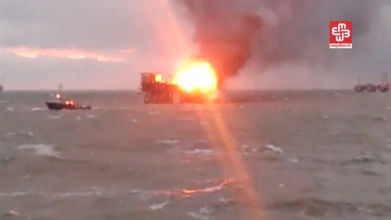 A still image from a video footage shows an oil platform on fire in the Caspian Sea, Azerbaijan, December 5, 2015. Thirty-two workers have died after an offshore oil platform operated by Azerbaijan's state energy company SOCAR caught fire in the Caspian Sea, the head of an independent committee said on Saturday. SOCAR said on Friday that the fire on a platform in Azerbaijan's Guneshli oil field had started after a gas pipeline on the platform was damaged in heavy wind. REUTERS/MEYDAN TV via Reuters TV ATTENTION EDITORS - THIS IMAGE WAS PROVIDED BY A THIRD PARTY. REUTERS IS UNABLE TO INDEPENDENTLY VERIFY THE AUTHENTICITY, CONTENT, LOCATION OR DATE OF THIS IMAGE. IT IS DISTRIBUTED EXACTLY AS RECEIVED BY REUTERS, AS A SERVICE TO CLIENTS. FOR EDITORIAL USE ONLY. NOT FOR SALE FOR MARKETING OR ADVERTISING CAMPAIGNS. NO RESALES. NO ARCHIVE. THIS IMAGE HAS BEEN SUPPLIED BY A THIRD PARTY. MANDATORY CREDIT