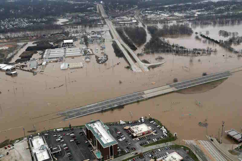 An aerial view from a Missouri National Guard UH-60 Black Hawk helicopter shows the effects of flooding in Pacific, Missouri, December 30, 2015. Missouri, Illinois, Arkansas and eastern Oklahoma braced for more flooding on Thursday as rain-swollen rivers, some at record heights, overflowed their banks, washing out hundreds of structures, closing major highways and leaving thousands of people displaced from their homes. Picture taken December 30, 2015. REUTERS/Missouri National Guard/Handout via Reuters THIS IMAGE HAS BEEN SUPPLIED BY A THIRD PARTY. IT IS DISTRIBUTED, EXACTLY AS RECEIVED BY REUTERS, AS A SERVICE TO CLIENTS. FOR EDITORIAL USE ONLY. NOT FOR SALE FOR MARKETING OR ADVERTISING CAMPAIGNS