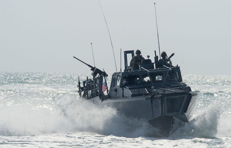 151102-N-CJ186-300 ARABIAN GULF (Nov. 2, 2015) Riverine Command Boat (RCB) 805, assigned to Commander, Task Group (CTG) 56.7, transits through the Arabian Gulf during patrol operations. RCBs were originally used in shallow-water and tropic environments. In the U.S. 5th Fleet area of operation these boats have been repurposed for open-sea patrol. CTG 56.7 conducts maritime security operations to ensure freedom of movement for strategic shipping and naval vessels operating in the inshore and coastal areas of the U.S. 5th Fleet area of operations. (U.S. Navy photo by Mass Communication Specialist 2nd Class Torrey W. Lee/Released)
