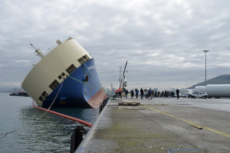 The cargo ship Modern Express lists at a mooring in the port of Bilbao, in Zierbena, northern Spain, February 4, 2016. Photo credit: REUTERS/Vincent West