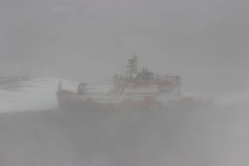 The Australian icebreaker Aurora Australis aground at West Arm in Horseshoe Harbour, near the Mawson station in Antarctica. Photo credit: Australian Antarctic Division