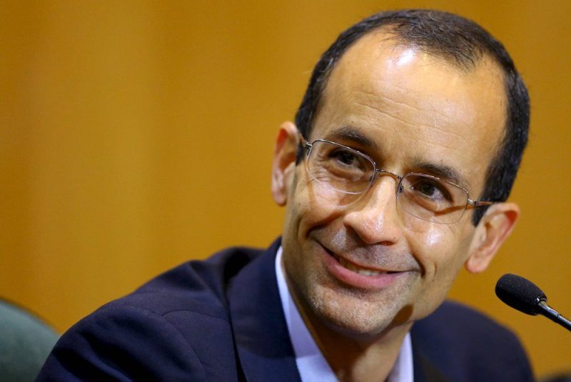 Marcelo Odebrecht smiles as he gives his testimony in a session of the Parliamentary Committee of Inquiry in Curitiba, Brazil, in this September 1, 2015 file photo. REUTERS/Rodolfo Buhrer/Files