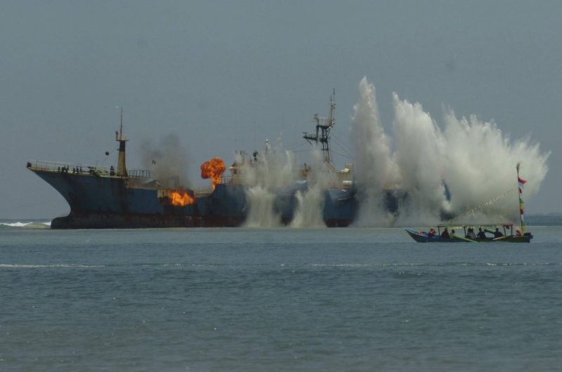 Photos indonesia blows up notorious poaching vessel for Blow up boat for fishing
