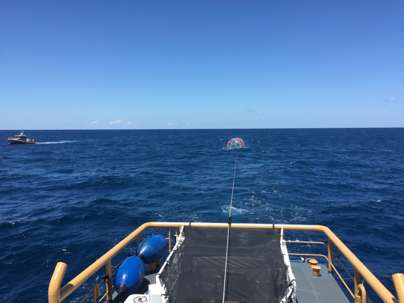 The crew of the Coast Guard Cutter Gannet tow a hydro pod off the coast of Jupiter, Florida, April 24, 2016. U.S. Coast Guard photo.