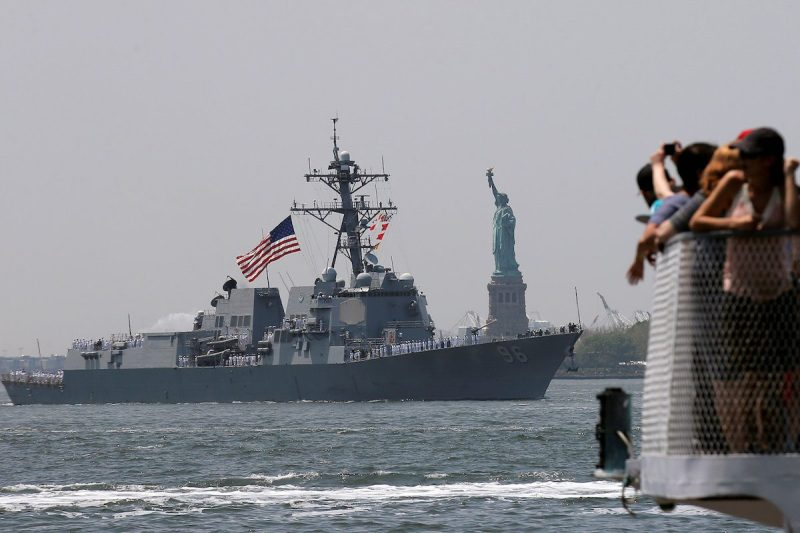 Tourists aboard a Statue of Liberty ferry watch as the Arleigh Burke-class guided missile destroyer, USS Bainbridge, arrives in New York Harbor to mark the beginning of Fleet Week in New York City, U.S., May 25, 2016. REUTERS/Brendan McDermid