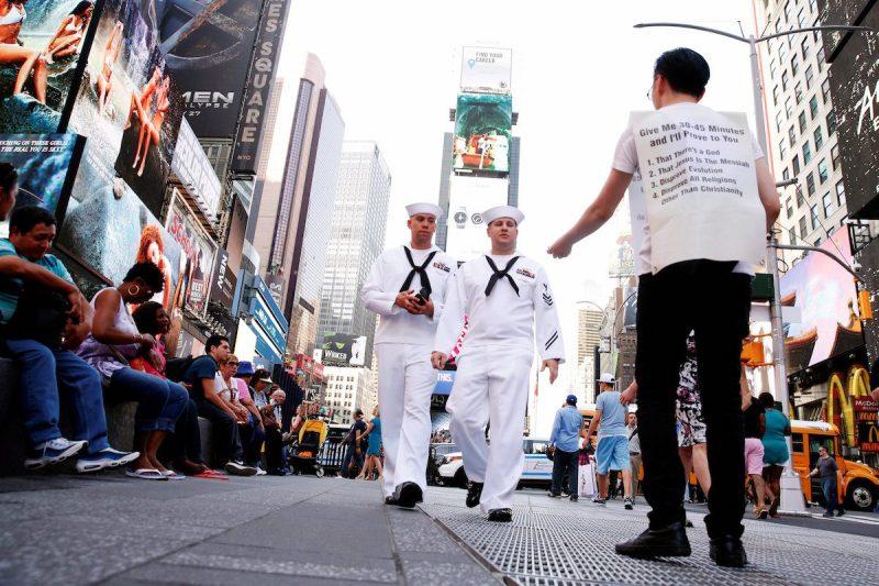 U.S. Navy sailors walk through Times Square during Fleet Week in New York, U.S., May 25, 2016. REUTERS/Lucas Jackson