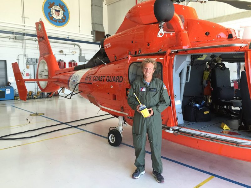 Olivier Jehl, a French sailor, shows off his EPIRB at Coast Guard Air Station Atlantic City, N.J., Monday, May 16, 2016, after he was rescued by the Coast Guard. Jehl was attempting a solo voyage from New York to the United Kingdom when his 21-foot sailboat struck a submerged object and sank, causing him to use his rescue raft, emergency position-indicating radio beacon and flares. (U.S. Coast Guard photo by Chief Petty Officer Nick Ameen)