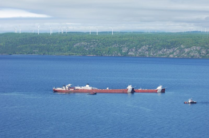 The motor vessel Phillip R. Clarke arrives on scene with the motor vessel Roger Blough, which ran aground May 27, near Gros Cap Reefs Light in Lake Superior, June 2, 2016. The Clarke is scheduled to remove some of the taconite from the Blough in order to lighten the Blough so it can be refloated. (Photo courtesy of Transport Canada)