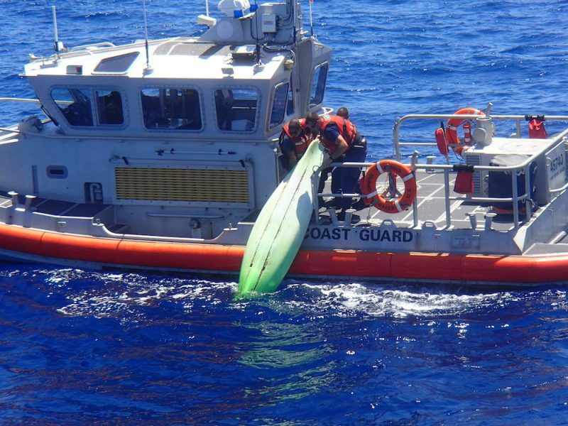 Coast Guardsmen with Coast Guard Station Fort Myers Beach, Florida, pull a green kayak on board their response boat off the coast of Sanibel, Florida, June 22, 2016. The kayak is believed to belong to a missing family who were last seen aboard a sailboat. U.S. Coast Guard photo.