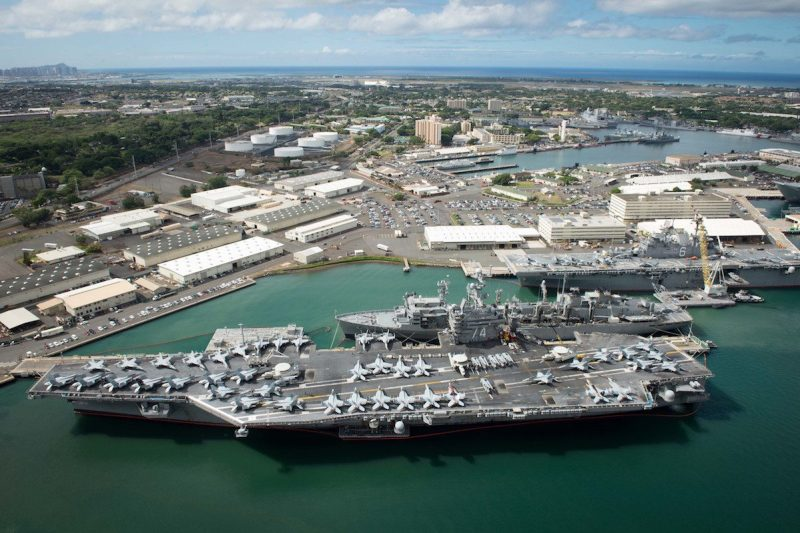 160706-N-SI773-499 JOINT BASE PEARL HARBOR-HICKAM (July 6, 2016) An aerial view of ships moored at Joint Base Pearl Harbor-Hickam for Rim of the Pacific 2016. Twenty-six nations, more than 40 ships and submarines, more than 200 aircraft, and 25,000 personnel are participating in RIMPAC from June 30 to Aug. 4, in and around the Hawaiian Islands and Southern California. The world's largest international maritime exercise, RIMPAC provides a unique training opportunity that helps participants foster and sustain the cooperative relationships that are critical to ensuring the safety of sea lanes and security on the world's oceans. RIMPAC 2016 is the 25th exercise in the series that began in 1971. (U.S. Navy Combat Camera photo by Mass Communication Specialist First Class Ace Rheaume/Released)