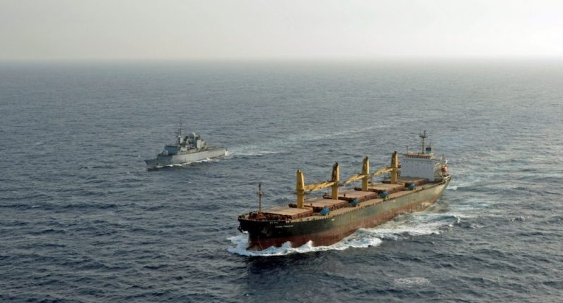 An EU Naval Force warship escorts a World Food Programme (WFP) chartered vessel in the Gulf of Aden. Photo: EU Navfor