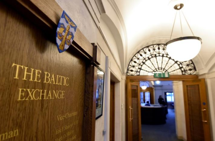 A wooden plaque is seen on a wall at The Baltic Exchange in the City of London