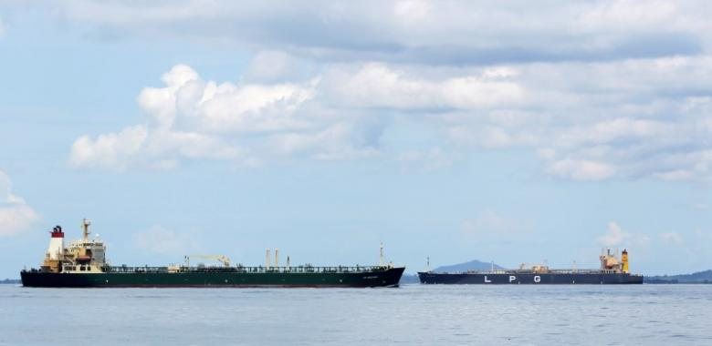 """Oil tanker """"AS Oceania"""" sails past a LPG tanker near the Raffles Lighthouse in southern Singapore"""