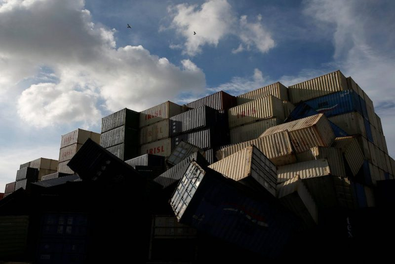 Birds fly over the toppled shipping containers after Typhoon Meranti made landfall, in Kaohsiung, Taiwan September 15, 2016. REUTERS/Tyrone Siu