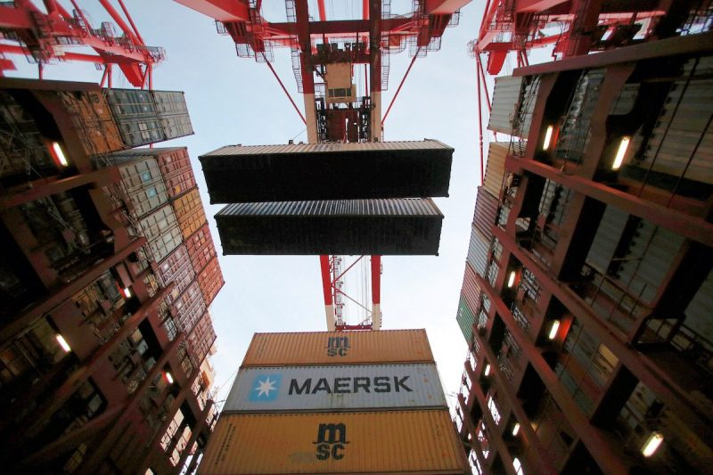 Containers are seen unloaded from the Maersk's Triple-E giant container ship Maersk Majestic, one of the world's largest container ships, at the Yangshan Deep Water Port, part of the Shanghai Free Trade Zone, in Shanghai, China, September 24, 2016. Picture taken September 24, 2016. REUTERS/Aly Song TPX IMAGES OF THE DAY