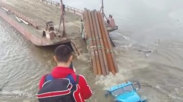 WATCH: Truck FAILS at Backing Onto Barge