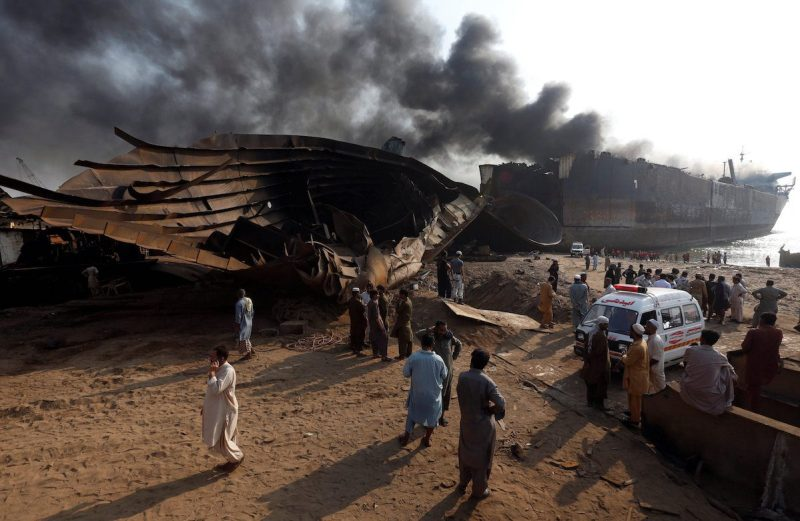 Rescue workers and family members of missing labourers gather and wait near the burning oil tanker at the Gaddani ship-breaking yard, 45 km (28 miles) of Karachi, Pakistan, November 2, 2016. REUTERS/Akhtar Soomro TPX IMAGES OF THE DAY