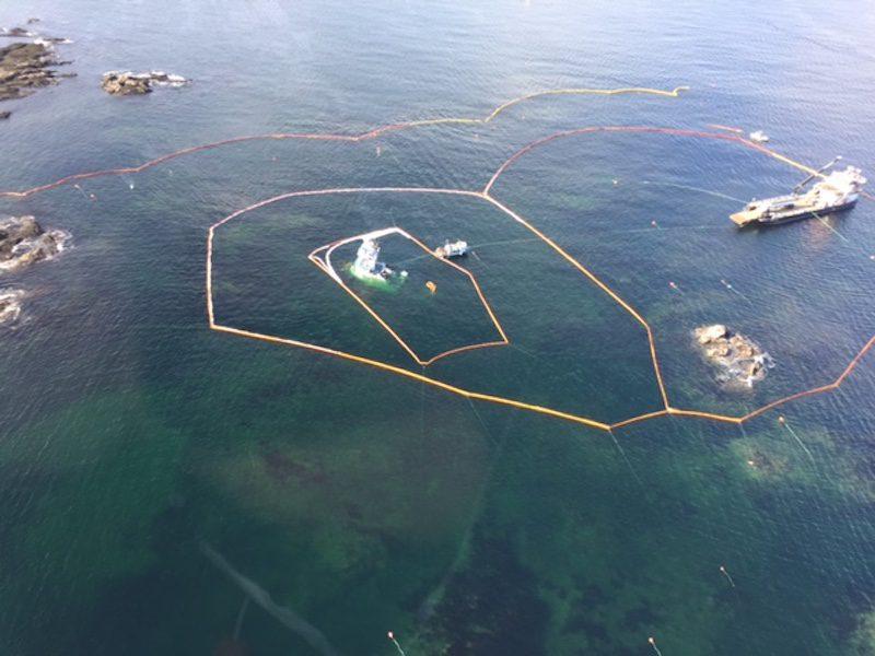 Boom surrounds the sunken tug Nathan E. Stewart near Bella Bella. Photo: WCMRC