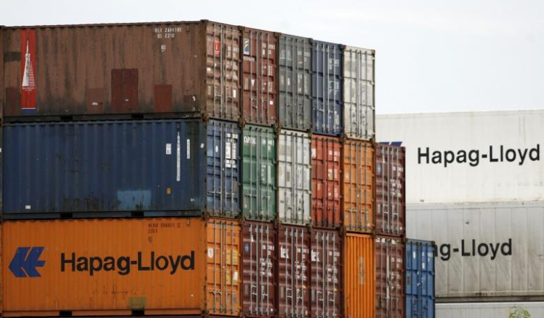 Shipping containers belonging to German transportation firm Hapag-Lloyd are seen stacked at a port in Singapore