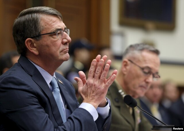 "U.S. Defense Secretary Ash Carter, left, and Joint Chiefs Chairman Marine Corps Gen. Joseph Dunford Jr. testify before a House Armed Services Committee hearing on ""U.S. Strategy for Syria and Iraq,"" in Washington, Dec. 1, 2015."