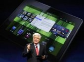 Mike Lazaridis, president and co-chief executive officer of Research in Motion, holds the new Blackberry PlayBook at the RIM Blackberry developers conference in San Francisco