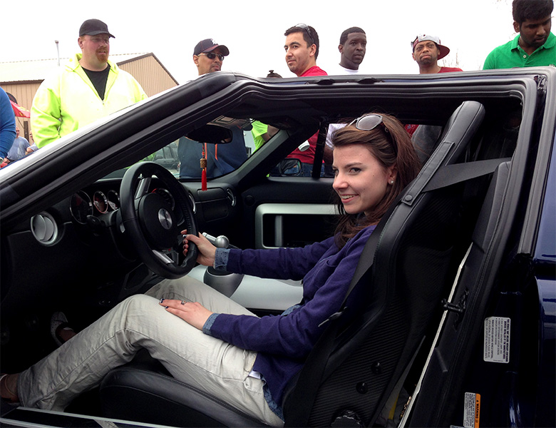Taylor Wilson is trying out the driver's seat in Michael Murray's beautiful Ford GT