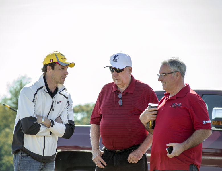 Casey, Michael, and the director of National Corvette Museum Motorsports Park discuss plans for the day.