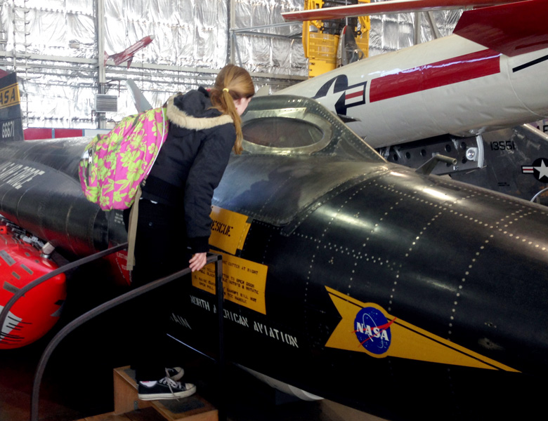 Isabelle takes a look into the window of one of the experimental NASA aircrafts.